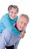 Senior couple enjoying piggyback ride Royalty Free Stock Images