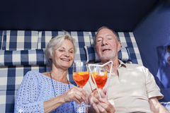 Senior couple enjoying retirement in summer garden chair Royalty Free Stock Photos