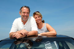 Senior couple enjoying road trip in cabriolet Royalty Free Stock Image