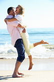 Senior Couple Enjoying Romantic Beach Holiday. Laughing Royalty Free Stock Photos