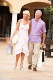 Senior Couple Enjoying Shopping Trip Royalty Free Stock Image