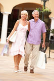 Senior Couple Enjoying Shopping Trip Stock Photos