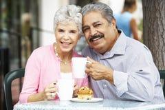 Senior Couple Enjoying Snack At Outdoor CafŽ royalty free stock photography