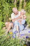 Senior couple enjoying summer in garden Stock Image