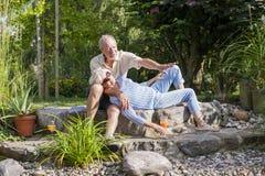 Senior couple enjoying summer in garden Royalty Free Stock Images
