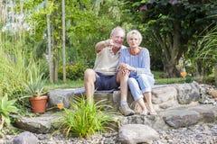 Senior couple enjoying summer in garden Stock Photo