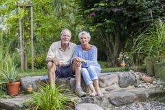 Senior couple enjoying summer in garden Stock Images