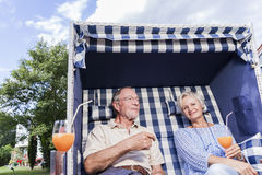 Senior couple enjoying summer in garden Stock Images
