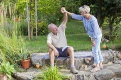 Senior couple enjoying summer in garden Royalty Free Stock Photos