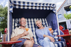 Senior couple enjoying summer in garden Royalty Free Stock Photo
