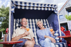 Senior couple enjoying summer in garden Stock Photo