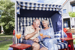Senior couple enjoying summer in garden Royalty Free Stock Photography