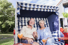 Senior couple enjoying summer in garden Royalty Free Stock Image