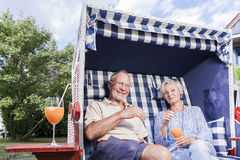 Senior couple enjoying summer in garden Royalty Free Stock Images