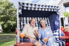 Senior couple enjoying summer in garden Stock Photos