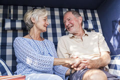 Senior couple enjoying summer in garden Stock Photography