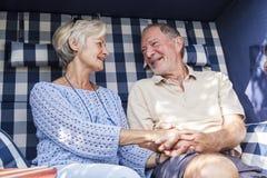 Senior couple enjoying summer in garden Stock Photography
