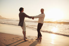 Senior couple enjoying their retirement on the beach Royalty Free Stock Photo