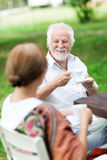Senior couple enjoying themselves outdoors Royalty Free Stock Photography