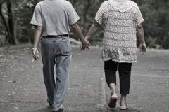 Senior couple enjoying a walk in the park Stock Images