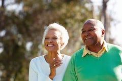 Senior Couple Enjoying Walk Together Stock Images