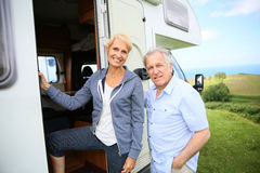 Senior couple entering camping car Royalty Free Stock Photos