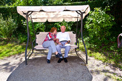 Senior couple enyoys the benach at the park in nymphenburg castle Stock Image