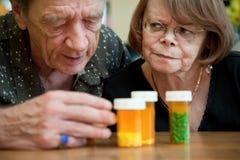 Senior couple examining medications Stock Image