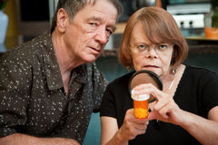 Senior couple examining medications Royalty Free Stock Photo