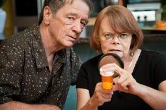 Senior couple examining medications Royalty Free Stock Photo