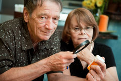 Senior couple examining medications Stock Image