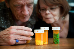 Senior couple examining medications Royalty Free Stock Image