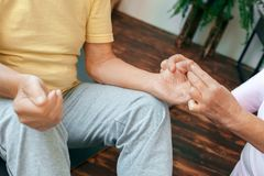 Senior couple exercise together at home health care hands acupressure royalty free stock image