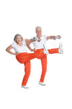 Senior Couple Exercising with dumbbells Stock Photo