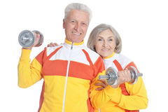 Senior Couple Exercising with dumbbells Stock Images