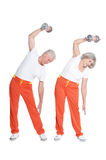 Senior Couple Exercising with dumbbells Royalty Free Stock Photography