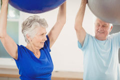 Senior couple exercising with exercise ball Stock Photography