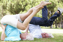 Senior Couple Exercising In Garden Together Royalty Free Stock Image