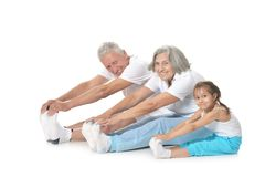 Senior couple exercising with granddaughter Stock Image