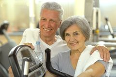Senior Couple Exercising In gym Stock Photography