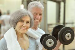 Senior Couple Exercising In gym Royalty Free Stock Images