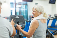 Senior couple exercising in gym Stock Image