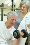 Senior couple exercising in gym Royalty Free Stock Photo