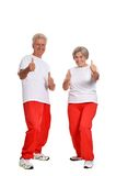 Senior couple exercising in gym Stock Images