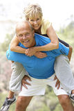 Senior Couple Exercising In Park Royalty Free Stock Images