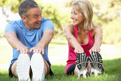 Senior Couple Exercising In Park Stock Images
