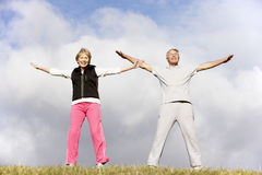 Senior Couple Exercising In The Park Stock Photography