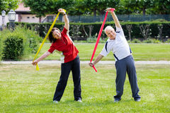 Senior Couple Exercising With Yoga Belt Royalty Free Stock Photos