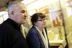 Senior couple at the exhibition Royalty Free Stock Photo