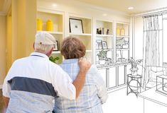 Senior Couple Facing Custom Built-in Shelves and Cabinets Design. Drawing Gradating to Finished Photograph royalty free stock photo